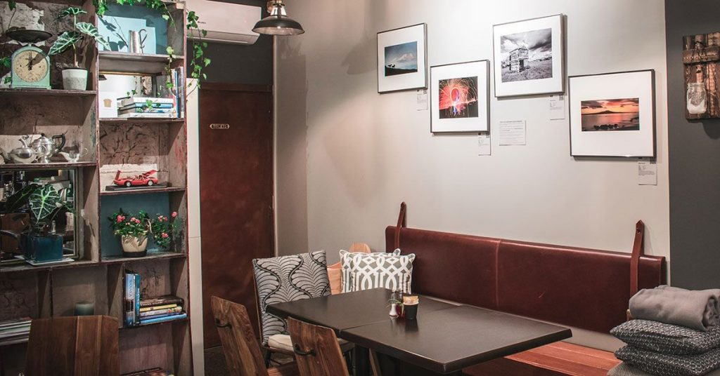 Joe's Eatery's feature wall of photography from North Shore Photography Society